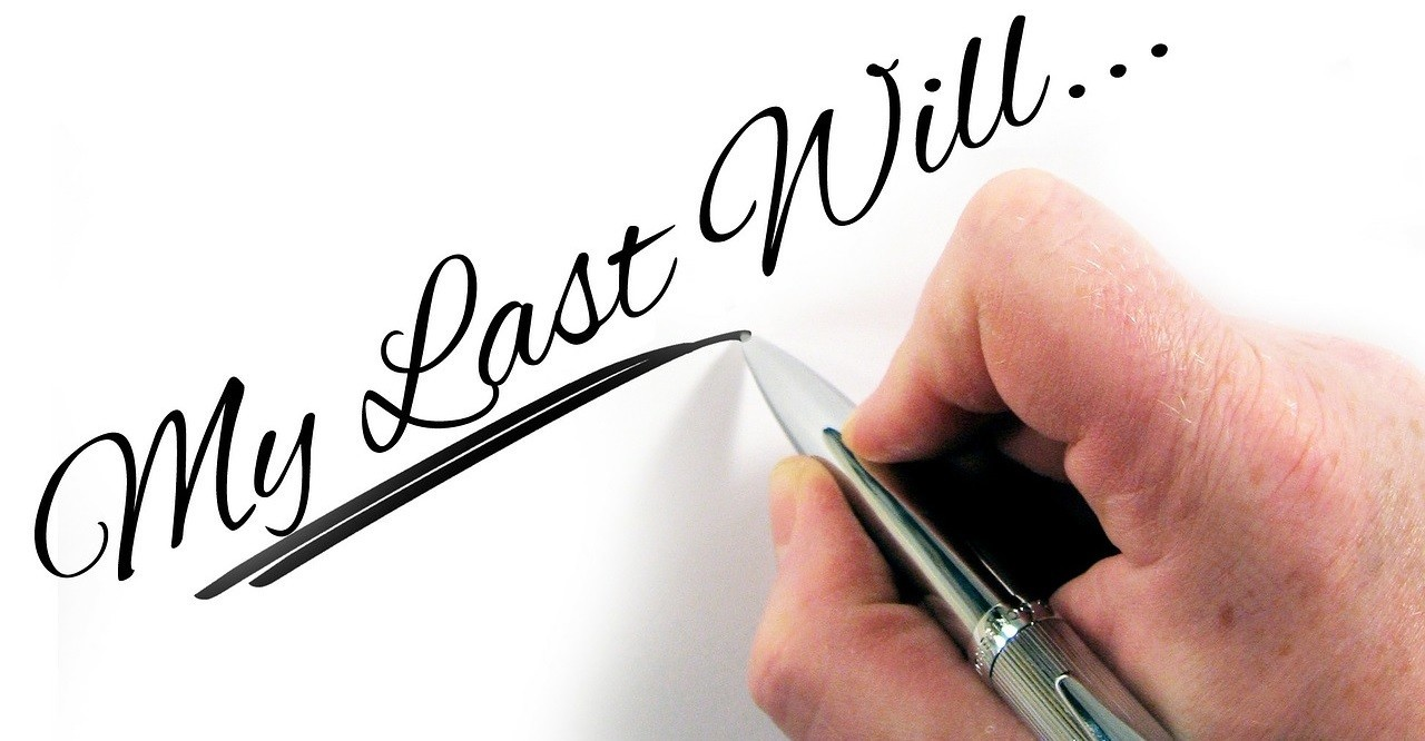Hand writing My Last Will with a pen