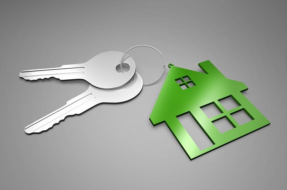 Image of a couple a keys on a keychain with a house pin.