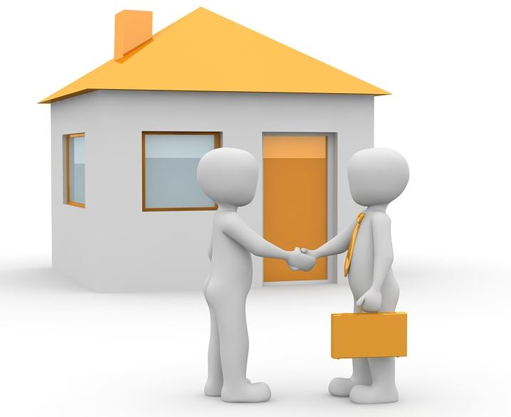 Image of two characters shaking hands to confirm a property deal.