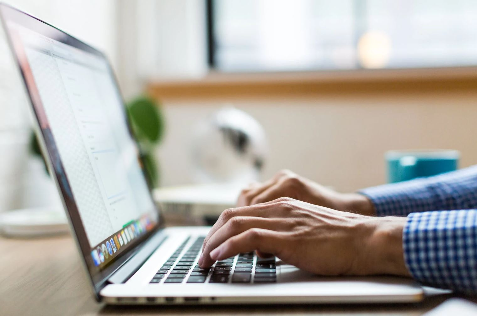 Image of a man using a laptop.